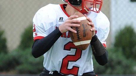 Plainedge's freshmen QB, #2 Nick Frenger, looks for