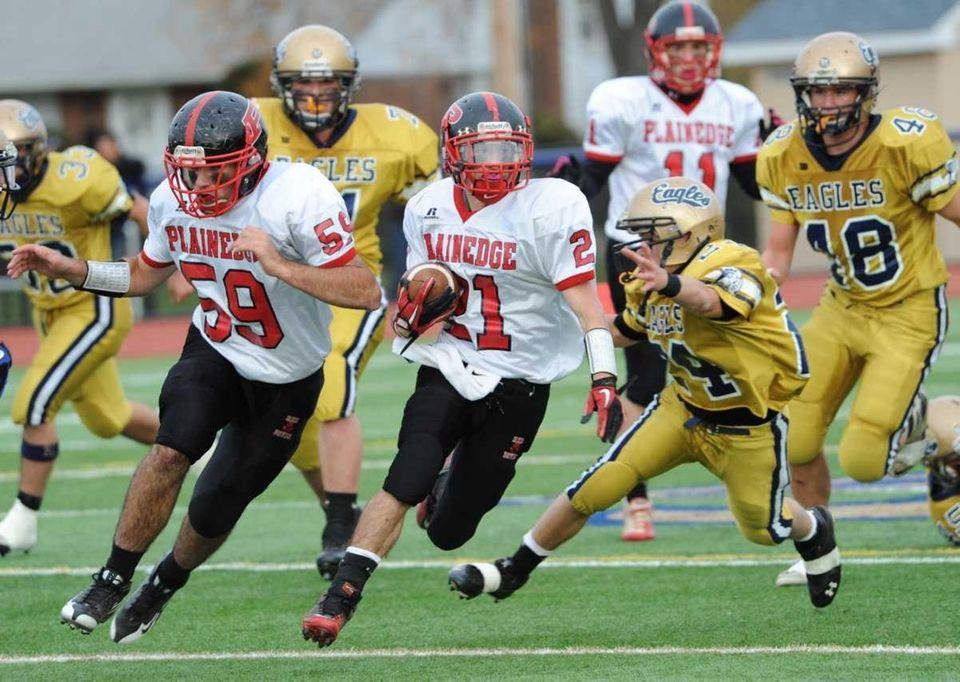 Plainedge's #59 Joseph Persico provides coverage for RB