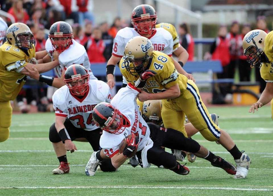 Plainedge's #21 Ralph Caccavale dives for additional rushing