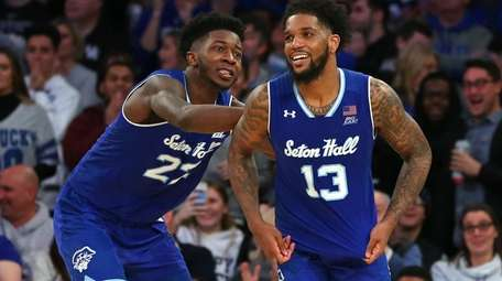 Myles Cale #22 and Myles Powell #13 of