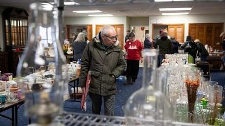 Dwight Eich of Sayville looks at household items