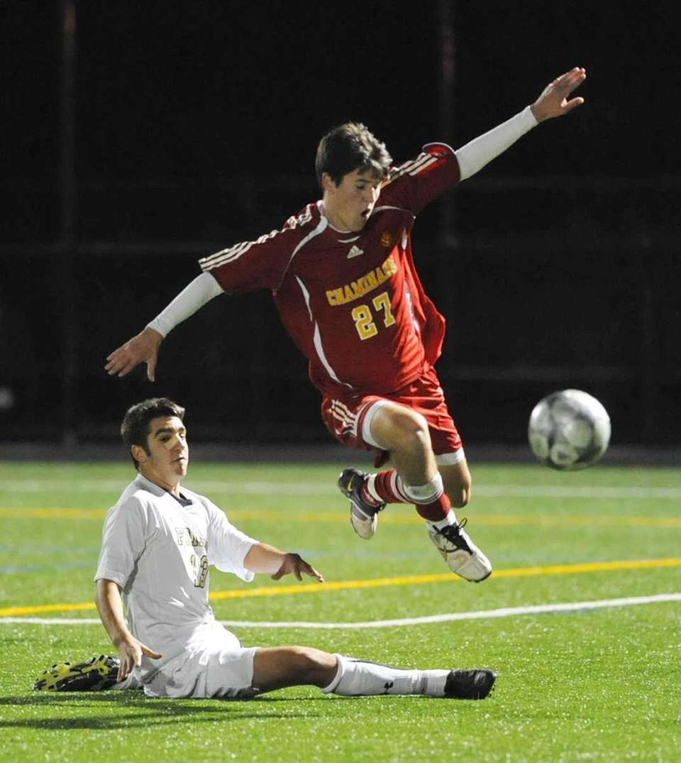 Chaminade's Terence McGovern (27, right), goes airborne after