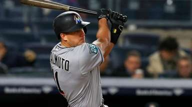 J.T. Realmuto #11 of the Miami Marlins follows