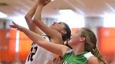 Emma LoPinto #12 of Manhasset, left, drives to