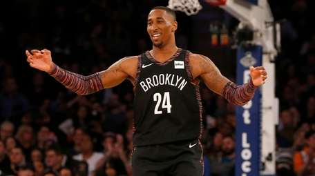 Rondae Hollis-Jefferson #24 of the Nets reacts after