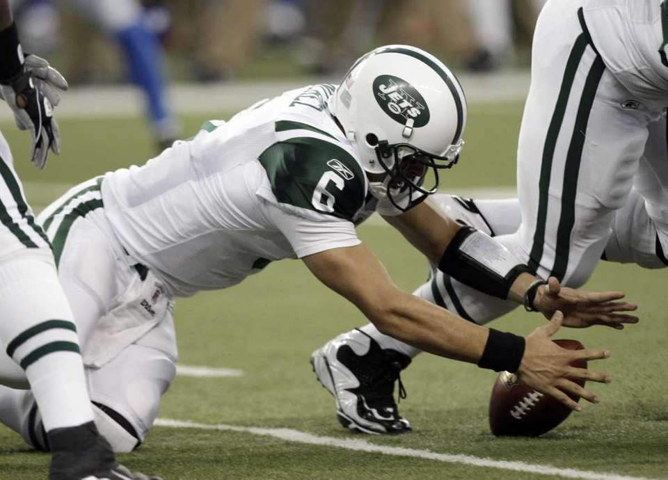 New York Jets quarterback Mark Sanchez (6) fumbles