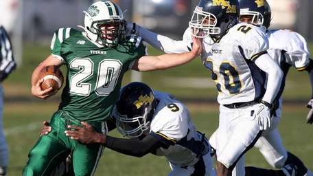 Holy Trinity's Michael Williams stiff-arms Mount St. Michael's