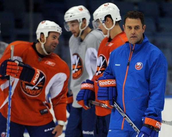 New York Islanders coach Scott Gordon watches practice