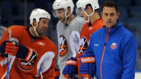 New York Islanders coach Scott Gordon watches practice