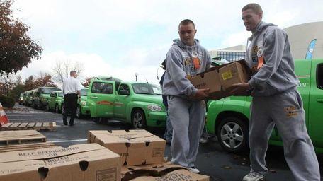 Workers unload 1,500 turkeys donated by ServPro Fire