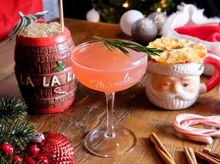 From left, the Christmas Carol Barrel; the Christmapolitan