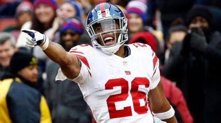 Giants running back Saquon Barkley celebrates his 78-yard