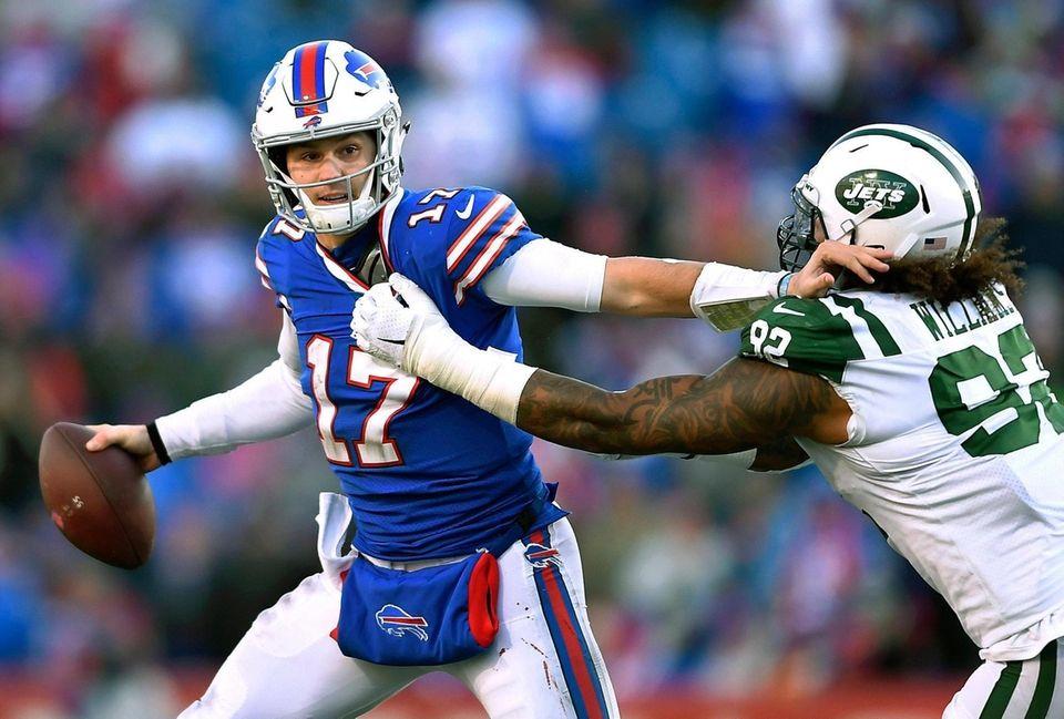 Buffalo Bills quarterback Josh Allen (17) tries to