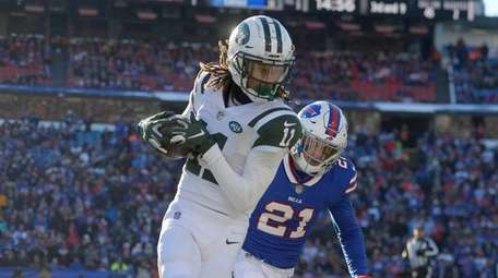 Jets wide receiver Robby Anderson runs from Bills