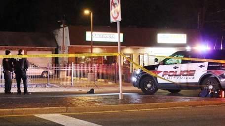Authorities investigate at the scene where a pedestrian