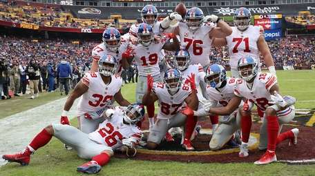Giants wide receiver Sterling Shepard celebrates with teammates