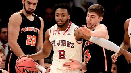 St. John's guard Shamorie Ponds is defended by