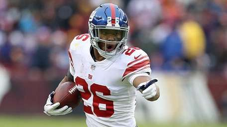 Giants running back Saquon Barkley carries the ball