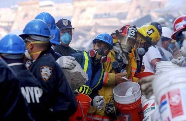 Rescue workers remove debris as they search for