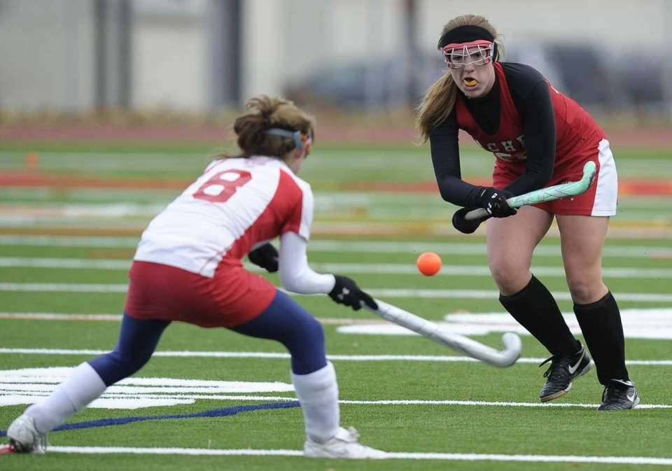 Sachem East's Jackie Morrison, right, passes the ball