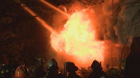 Firefighters battle a fatal fire on Elder Avevue