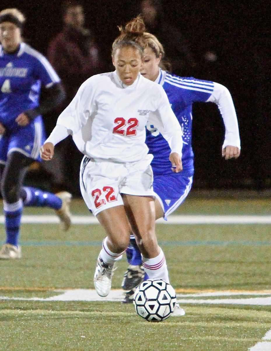 Center Moriches' Takia Plummer moves the ball out