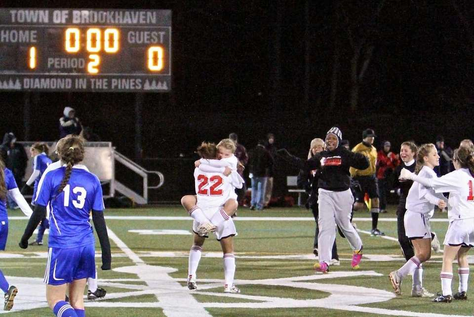 Center Moriches players celebrate after their 1-0 victory