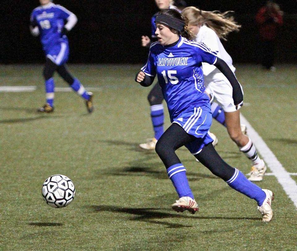 Mattituck midfielder Kelly Gatto (15) moves the ball