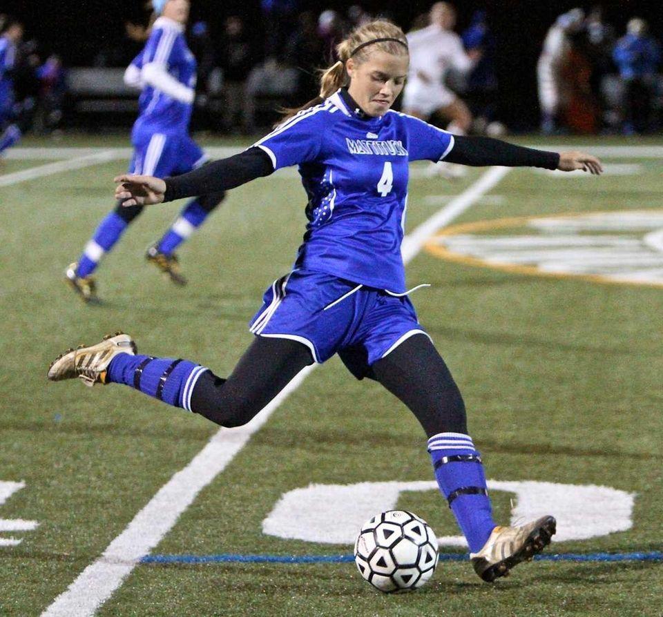 Mattituck midfielder Liz Lasota kicks the ball into