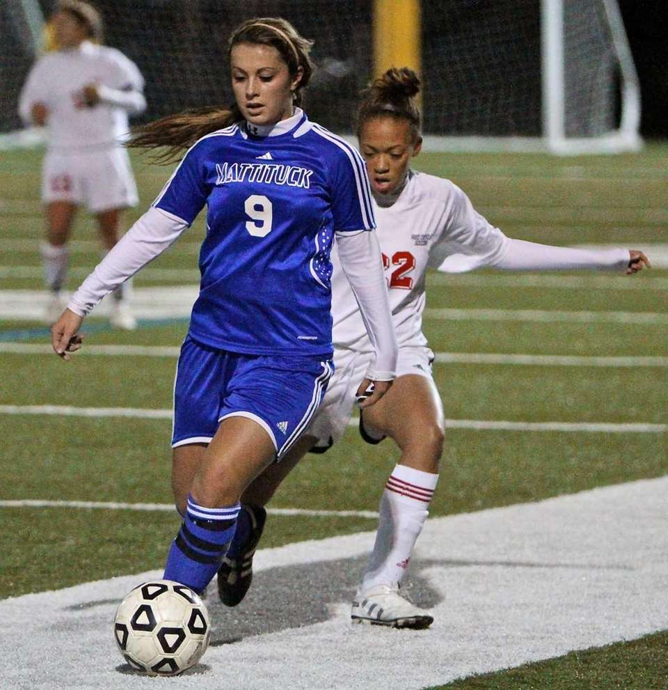 Mattituck forward Amber Mello, left, moves the ball