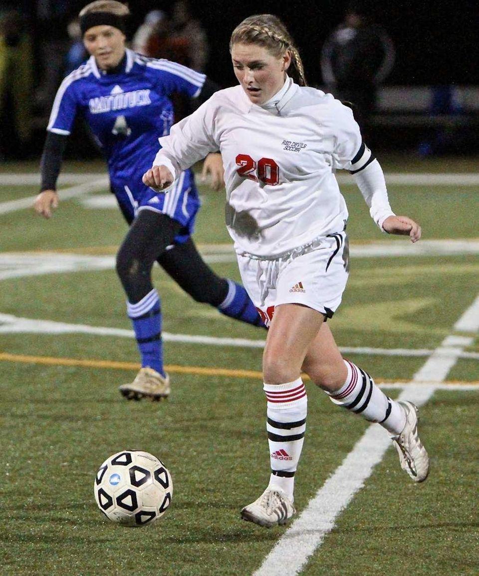 Center Moriches midfielder Emma Whittle dribbles the ball
