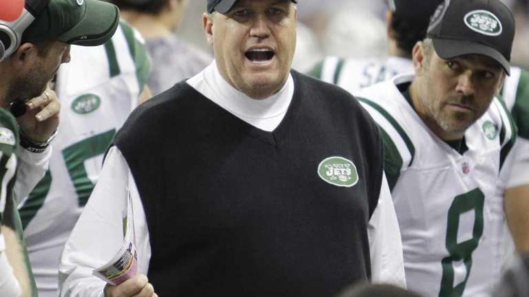 Jets coach Rex Ryan talks to his players