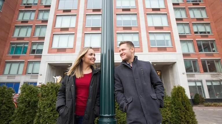 Micheli and John Ablamsky outside One Third Avenue