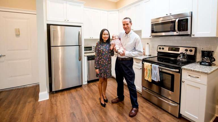 The Martins in the kitchen of their apartment.