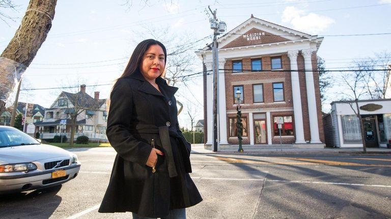 Jasmine Hernandez outside Meridian Lofts in Islip.