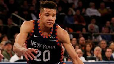 Kevin Knox of the Knicks controls the ball