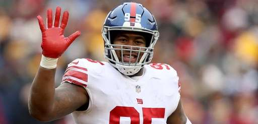 Giants defensive end B.J. Hill celebrates after the