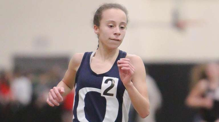 Andria Scaglione of Oceanside wins the 3,000-meter run