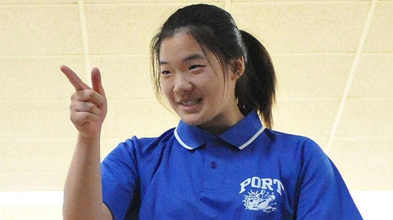 Sarah Chung of Port Washington points toward teammates