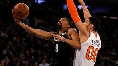 The Nets' Spencer Dinwiddie goes to the hoop