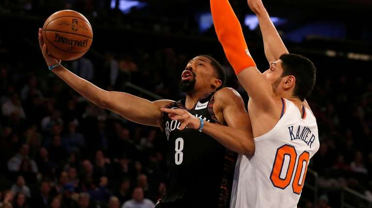 The Nets' Spencer Dinwiddie goes to the hoop