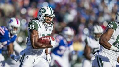 The Jets' Andre Roberts runs with the ball