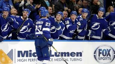 Lightning defenseman Ryan McDonagh celebrates with the bench