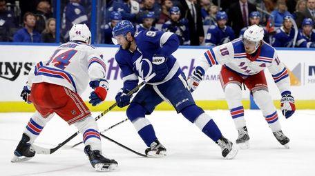 Lightning center Steven Stamkos gets between Rangers defenseman