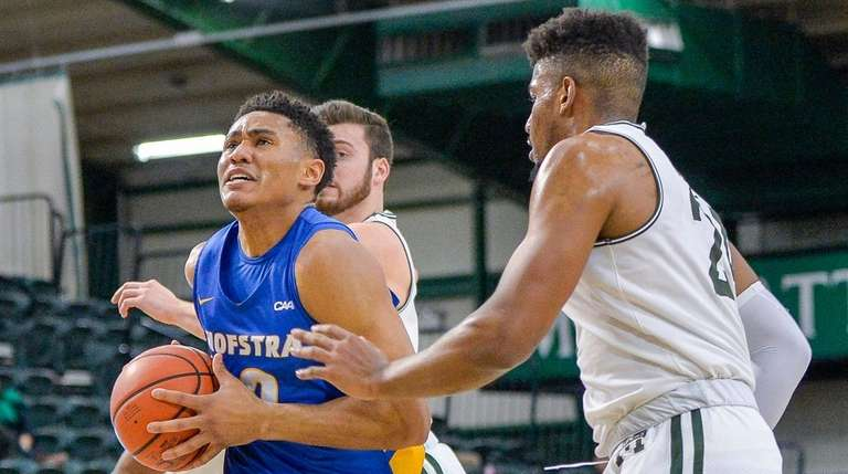 Hofstra guard Tareq Coburn drives past defenders on