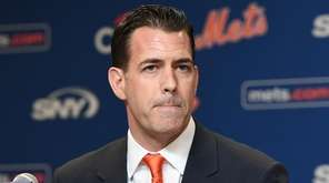 Mets general manager Brodie Van Wagenen looks on