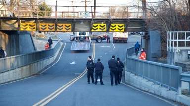 Railroad personnel and police inspect the scene of