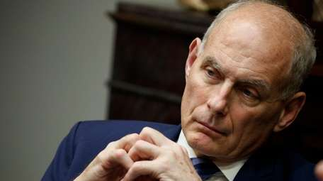 White House chief of staff John Kelly listens