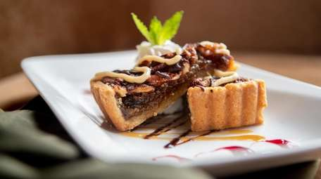 A chocolate-bourbon-pecan tart as served at OHK Restaurant