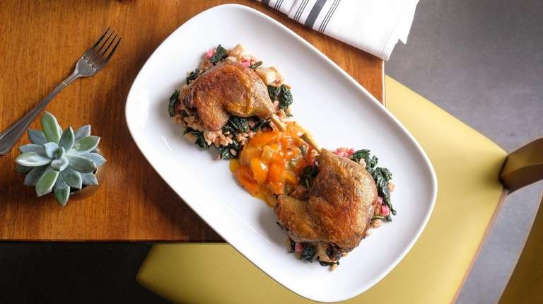 Crescent Farm duck confit sits on top of
